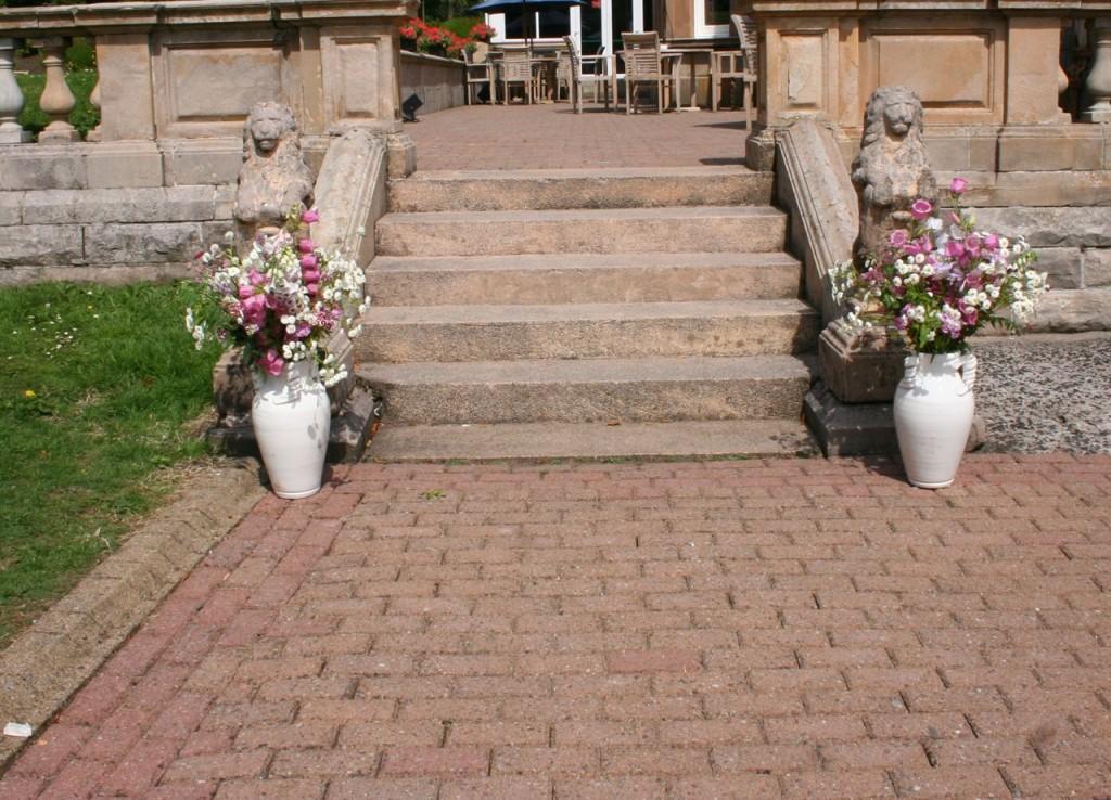 Gail flower filled urns July