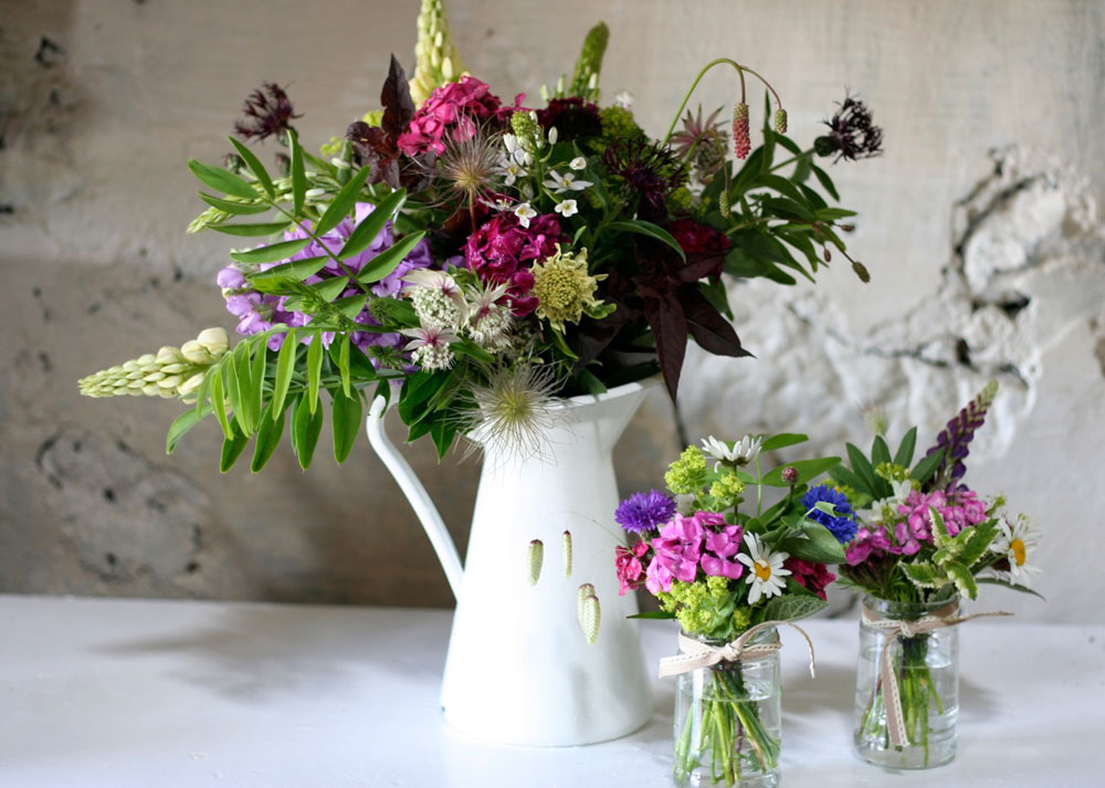 Natural flower arrangement and jam jars