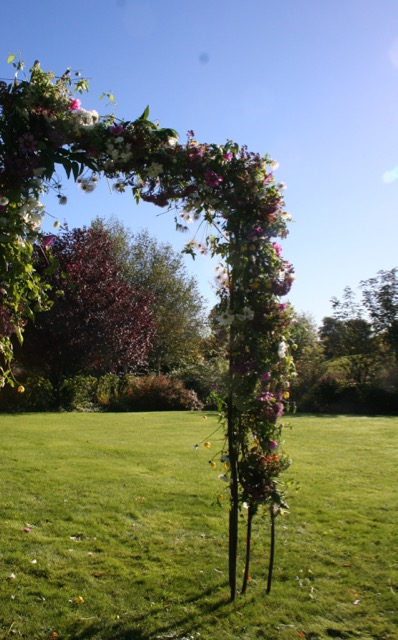 flower filled natural wedding arch